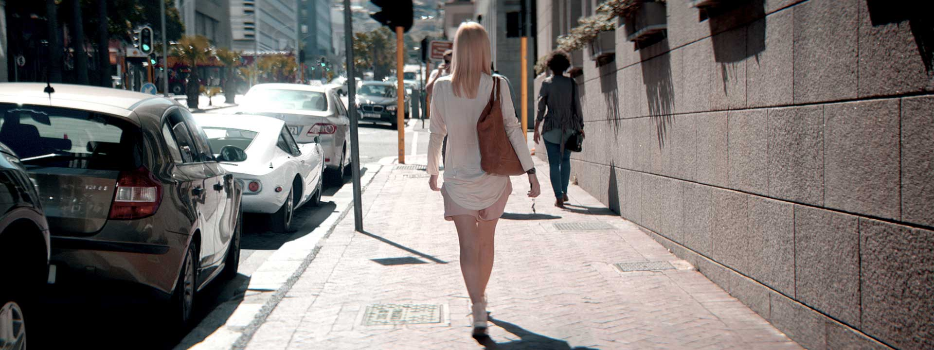 Woman on a sidewalk. Still from Toyota FT-86 open – Commercial