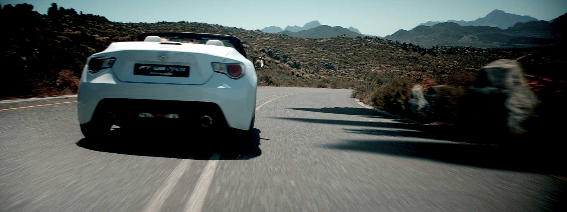 Woman driving car. Still from Toyota FT-86 open – Commercial