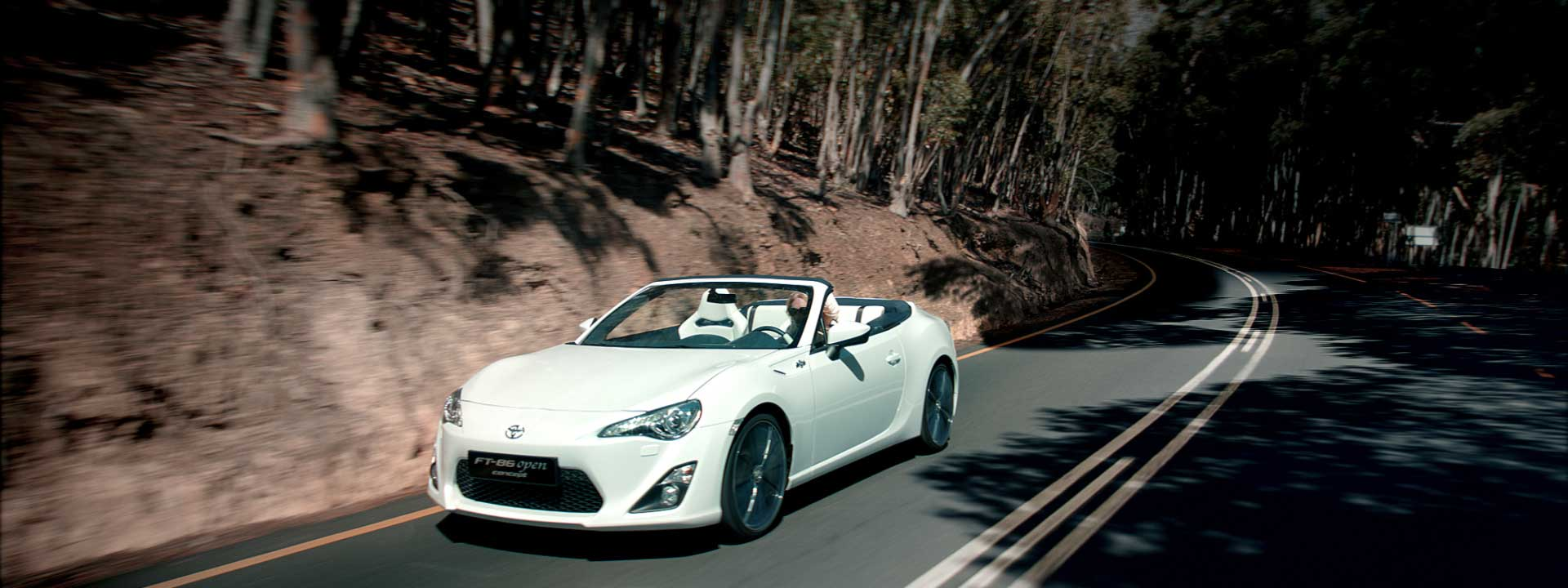 Woman behind steering wheel. Still from Toyota FT-86 open – Commercial