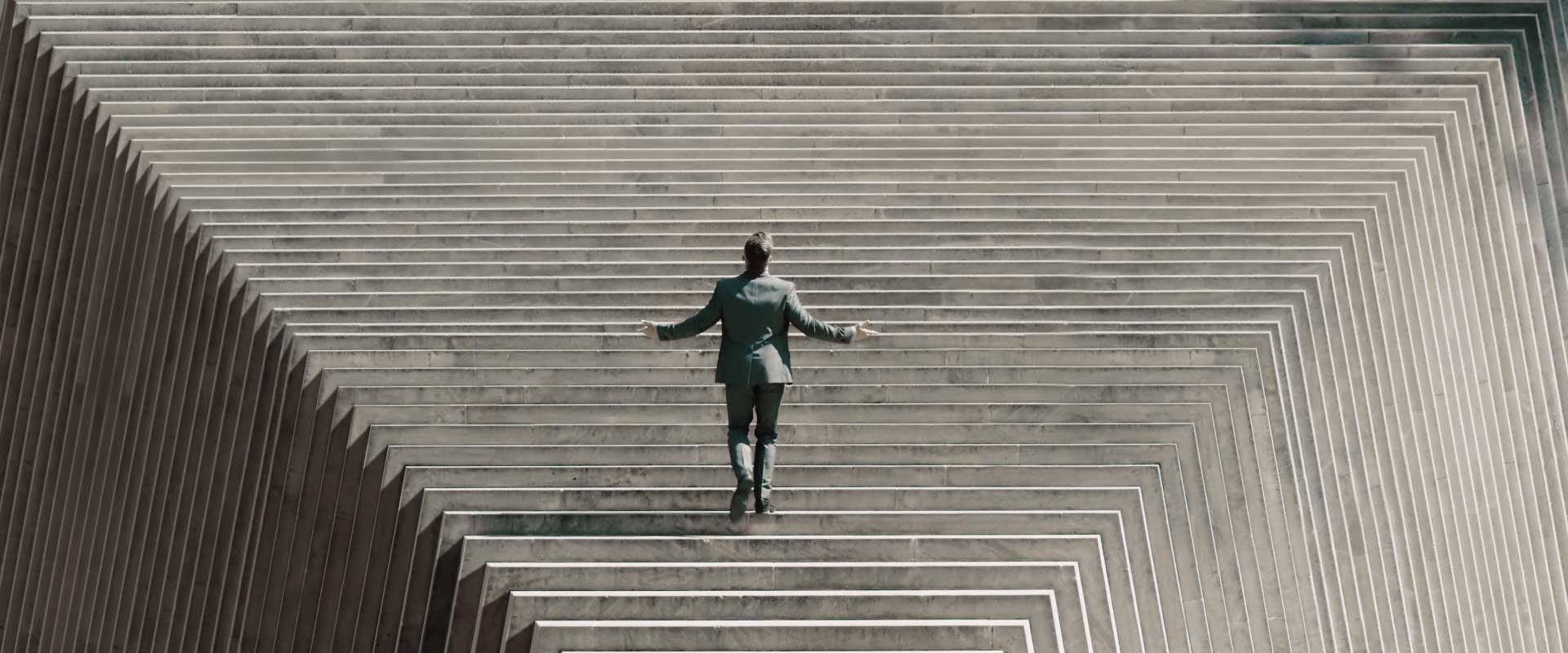 Men and stairs. Still from Lexus LX2016 Commercial.