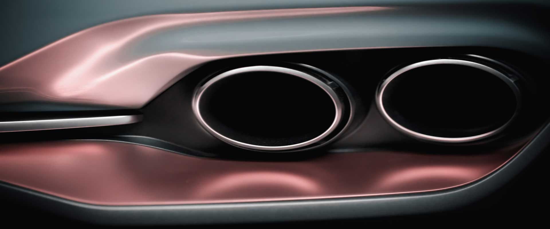 Detail exhaust pipes. Still from Hyundai Genesis commercial.