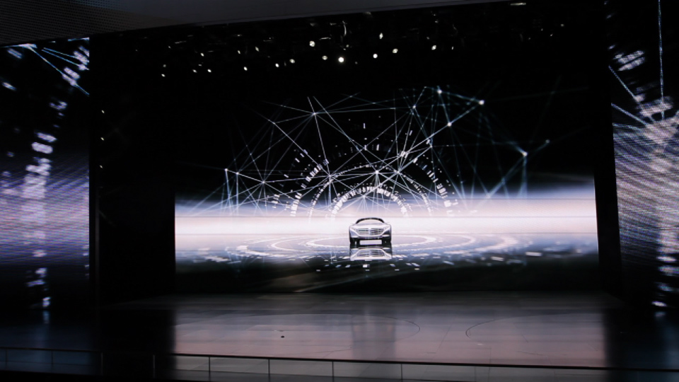 Car driving on stage. Mercedes-Benz IAA 2011 Trade Show