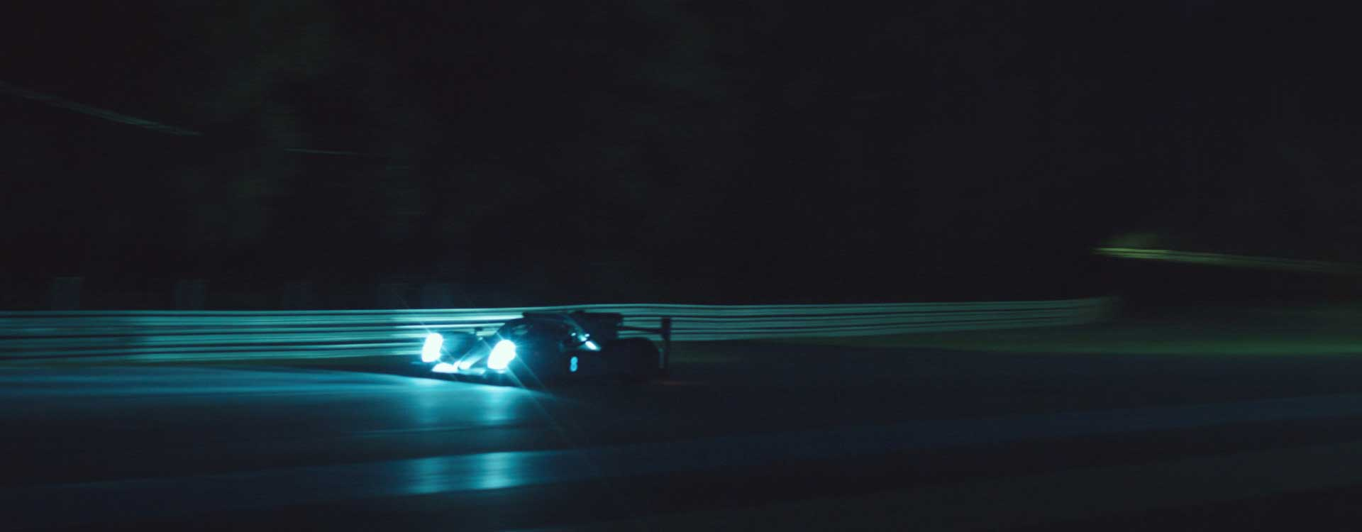 Moving racing car by night. Still from Toyota Hybrid Racing - Commercial Barbeque Design