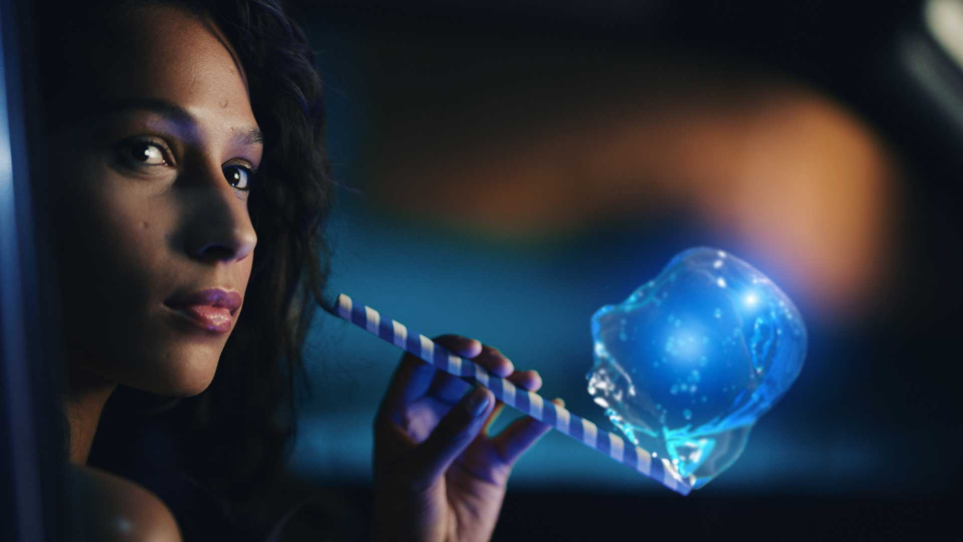 Woman with straw and bubble. Still from Toyota Yaris commercial.
