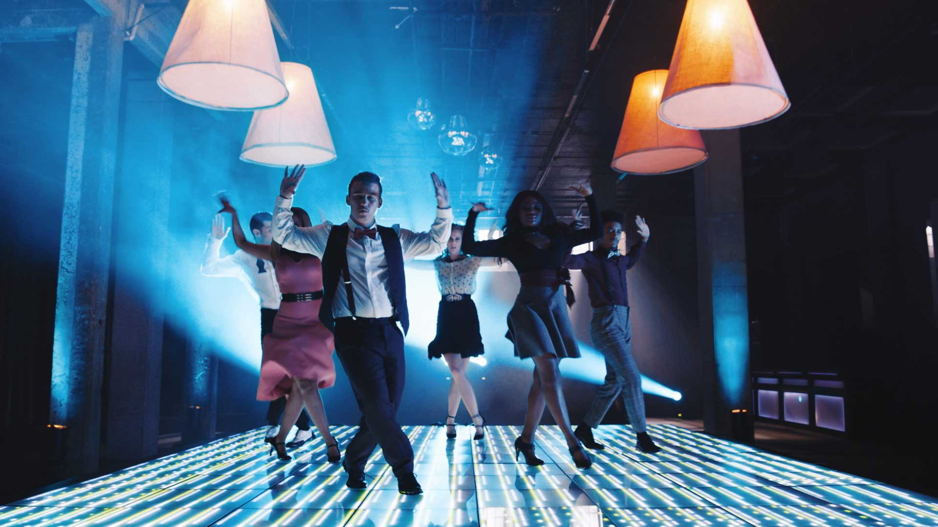 Dancing on stage. Still from Toyota Yaris commercial.